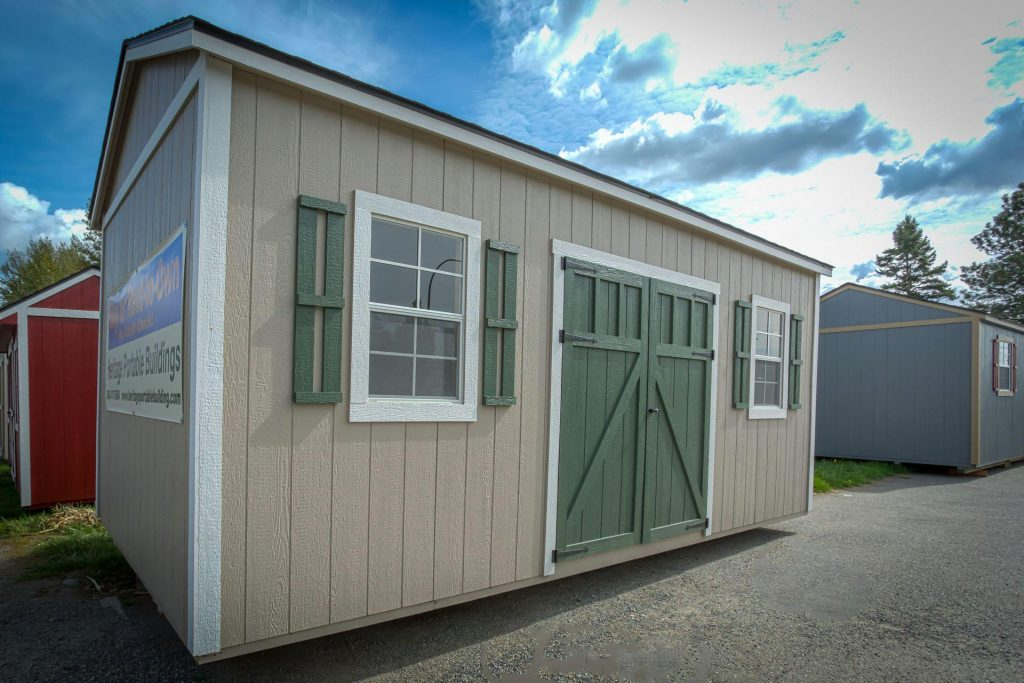 Heritage Portable | The La Conner | Beige Shed with Green Shutters