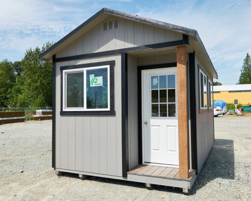 Light Gray Cabin with Dark Trim and Small Porch | Heritage Portable Buildings